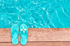 Sandals by a swimming pool, summer concept Royalty Free Stock Photography