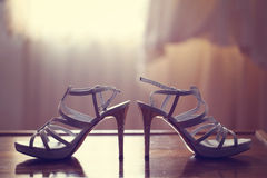 Sandals on table Stock Photography