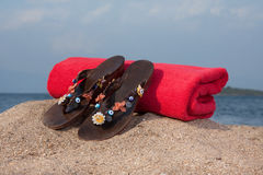 Sandals and towel Royalty Free Stock Photography
