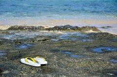 Sandals at tropical coast Royalty Free Stock Photo