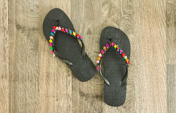 Sandals on wood floor. Beautiful sandals on wood floor Royalty Free Stock Photo