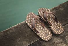 Sandals on wood Stock Images