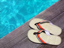Sandals on a wooden floor Royalty Free Stock Photo