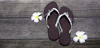 Sandals on a wooden floor Royalty Free Stock Image