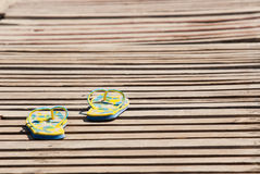 Sandals on wooden floor Royalty Free Stock Images
