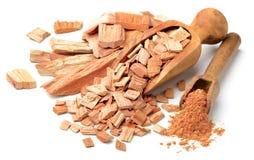 Sandalwood slice and powder in the scoop. Sandalwood slice and powder in the wooden scoop Stock Image