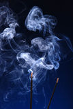 Sandalwood stick. Pooja stick release smoke effect Stock Photos