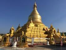 Sandamuni pagoda, in the city of Mandalay. Beautiful golden pagoda surrounded by white stupas. In the city of Mandalay, Myanmar stock image