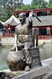 Sandaoyan, China: Baterista de bronze do barco do dragão Imagens de Stock Royalty Free