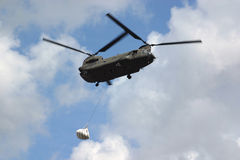 Sandbag Airlift. Military helicopter lifts sandbags to levee breaks after Hurricane Katrina Royalty Free Stock Photography