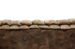 Sandbag wall. Wall of sandbags isolated on white Stock Photos