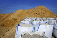 Sandbag white big bag sand sacks quarry Royalty Free Stock Photo