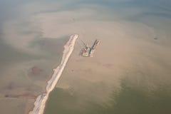 Sandbagger auf Lastkahn Stockfoto