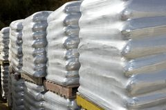 Sandbags bags white pallet sacks stacked Stock Images