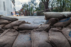 Sandbags barricade. Sandbags put on the street to prevent flooding royalty free stock photography