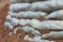 Sandbags för flodskydd Arkivbild