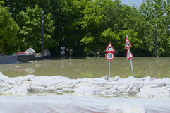 Sandbags Holding Back Flooding River. Sandbags Holding Back Flooding Danube River in Gyor, Hungary Stock Photo