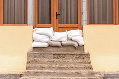 Sandbags house flood defense Royalty Free Stock Photos