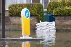Sandbags Outside House On Flooded Road royalty free stock image