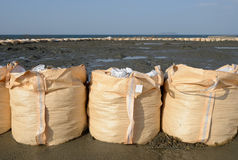 Sandbags for protection. Big sandbags for protection against a blue sky Stock Image