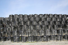 Sandbags for protection. Big sandbags for protection against a blue sky Royalty Free Stock Image