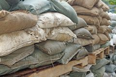 Sandbags to guard against attacks. Brown and green sandbags to guard against attacks stock photos