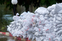 Sandbags to prevent flooding. Flood barrier made of sandbags in Nakhon Ratchasima during the monsoon flooding in October 2010, the worst flooding in 50 years in Royalty Free Stock Photo