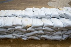 Sandbags to prevent flooding. Sandbag to prevent flooding in the rainy season, preventive concept stock photos