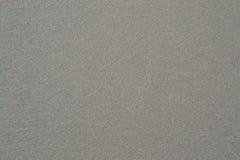 Sandbakgrund och texturerat arkivfoto