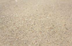Sandbakgrund texturerar Royaltyfri Foto