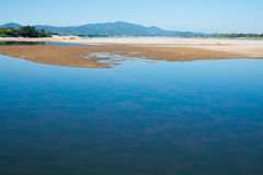 Sandbank of river in water foreground Royalty Free Stock Photos