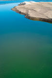 Sandbank of river in water foreground Stock Images