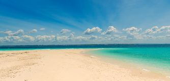 Sandbank with transparent turquoise water. And blue sky on the background Royalty Free Stock Images
