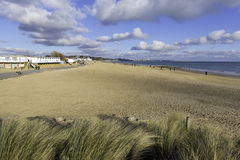 Sandbanks beach and waves Poole Dorset England UK. With blue sky and cloudscaope Stock Photography