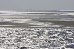 Sandbanks and sparkling sea water of dutch Waddenzee Royalty Free Stock Photography