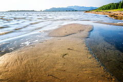 Sandbar on the shore by the sea Stock Images