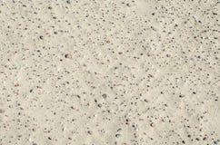 Sandbeschaffenheit mit Steinen Stockbilder