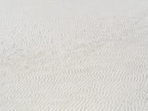 Sandbeschaffenheit, Streifen Muster und Hintergrund Stockfotografie