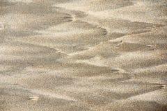 Sandbeschaffenheit und -hintergrund stockfotos