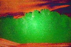 Sandbildgräsplan och apelsin Royaltyfria Foton