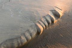 Sandbildung bei Sonnenuntergang lizenzfreies stockfoto
