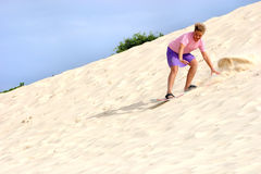 Sandboard fun. A teen having fun witha a sand board in Florianopolis-SC Brazil royalty free stock photos