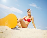 Sandboarder on beach Stock Images