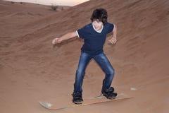 Sandboarding Стоковое Изображение