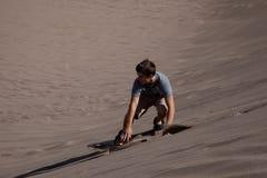 Sandboarding Imagen de archivo libre de regalías