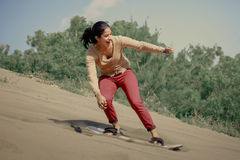 Sandboarding Image libre de droits