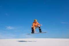 Sandboarding in desert at sunny day. Royalty Free Stock Photo
