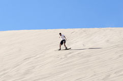 Sandboarding no deserto de Atacama imagem de stock royalty free