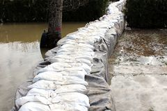 Sandbox barriers flood protection covered with geotextile fabric and sandbox flood protection added on top. Sandbox barriers flood protection completely covered royalty free stock photo