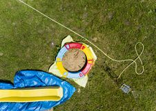 Sandbox and garden hose. Aerial view of a sandbox and garden hose on the green field royalty free stock photography
